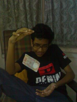 Debjit Chaudhuri levitating a bill