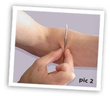pen in arm